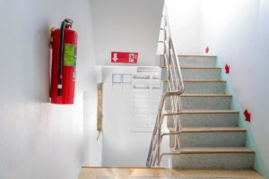 Fire exit sign and fire extinguisher
