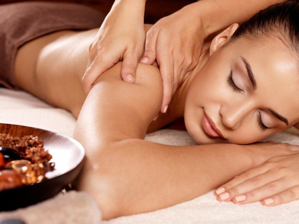 woman enjoying massage at spa