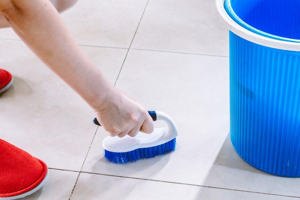 Floor tiles being cleaned