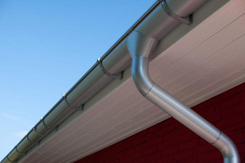 Roof gutter in front of blue sky