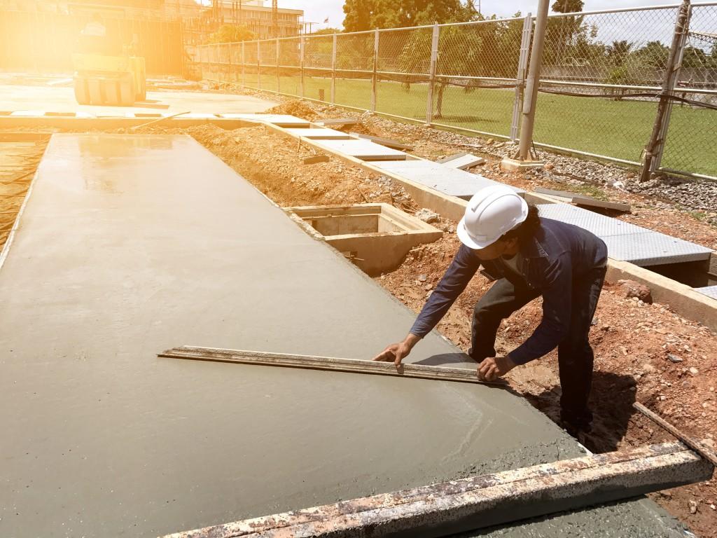 Man spreading concrete mix