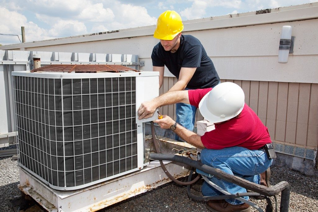 workers installing HVAC unit
