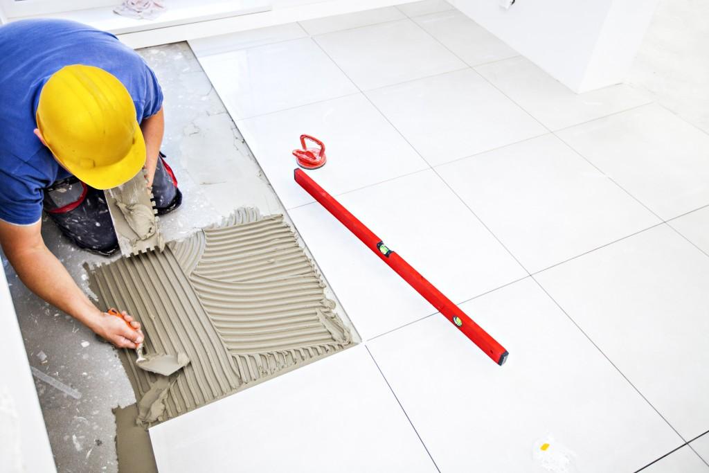 Man placing on tiles
