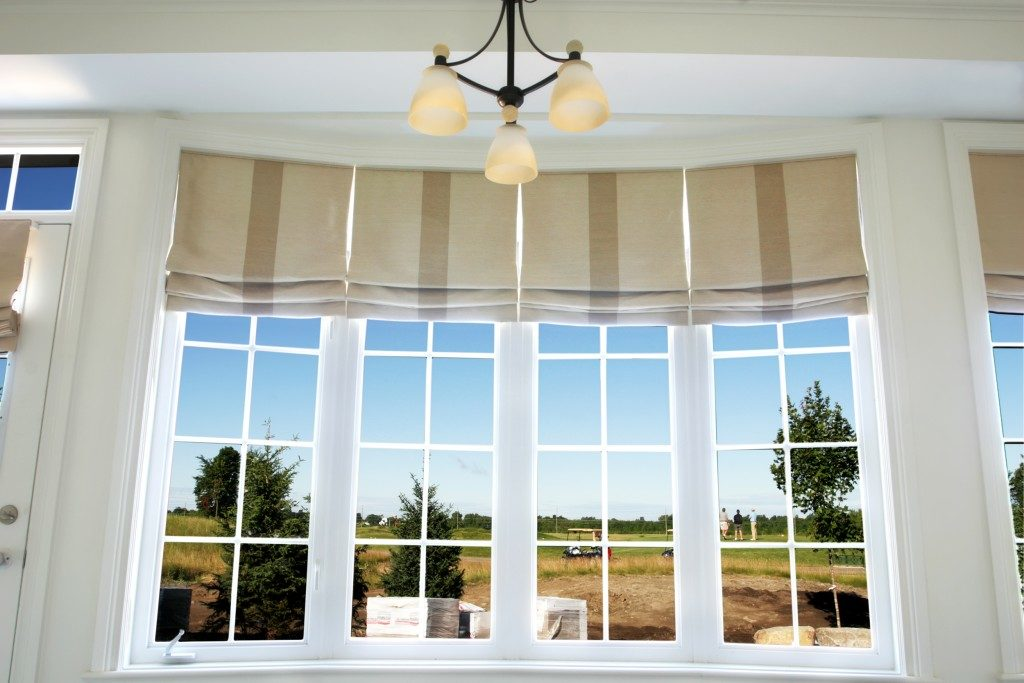 Interior of a model home showing drapery using roman shades