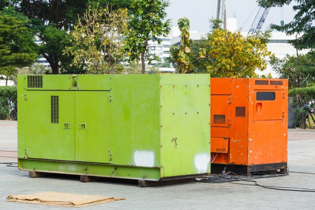 Rusty and old electric generator in construction plant