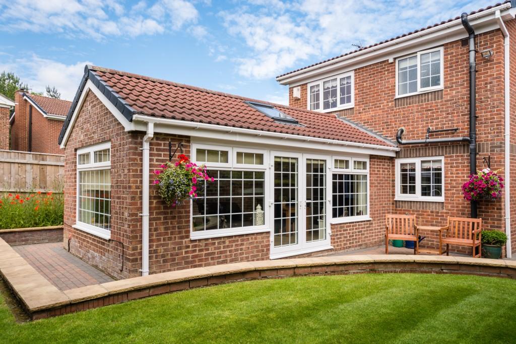 conservatory extending into the garden