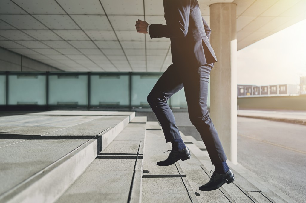 man walking on concrete stairs