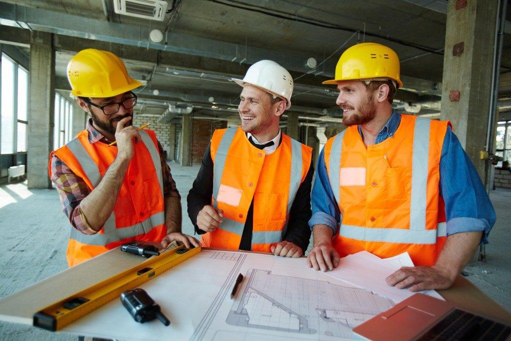 Men discussing the blueprint