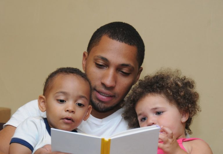 Father reading to his two kids