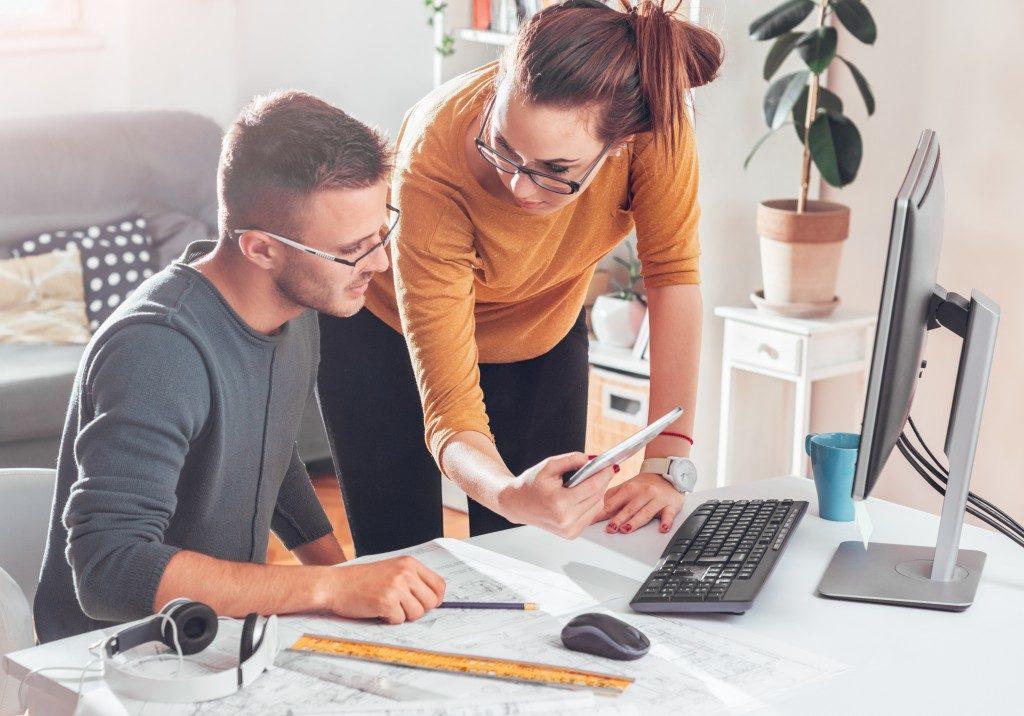 Designers discussing office interior