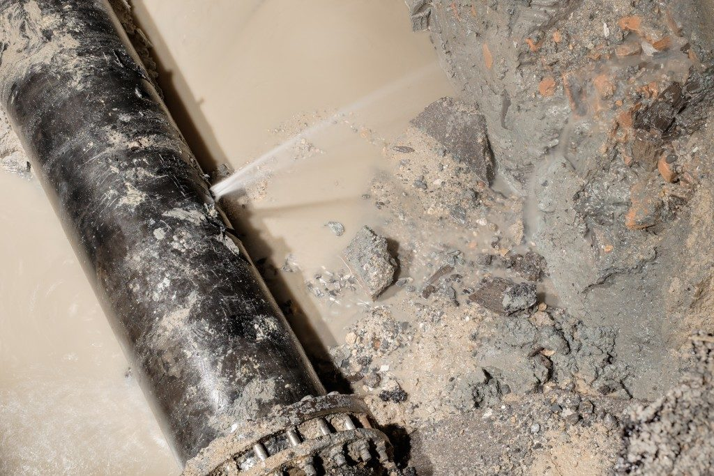 Busted water pipe causing water damage and flooding