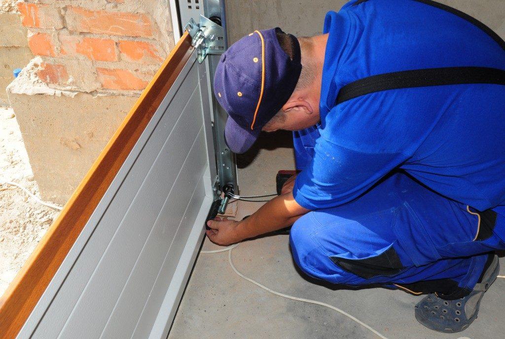 contractor fixing the garage door