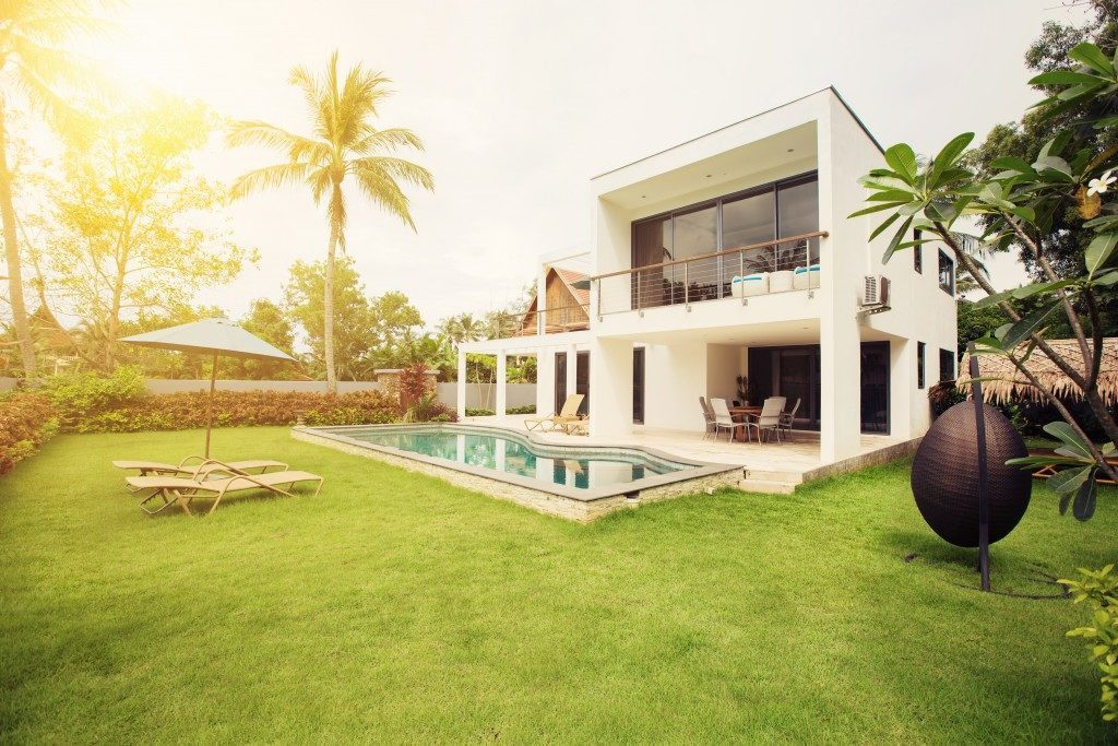 Modern house backyard with pool and garden