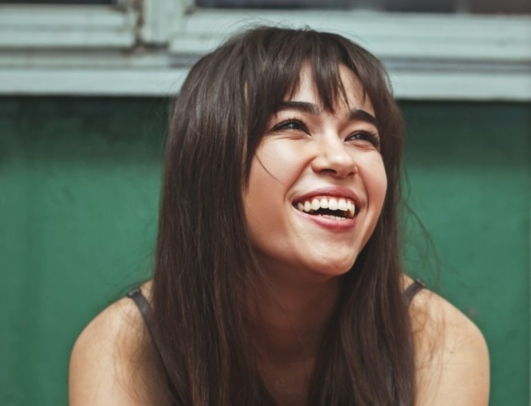 woman smiling and feeling happy