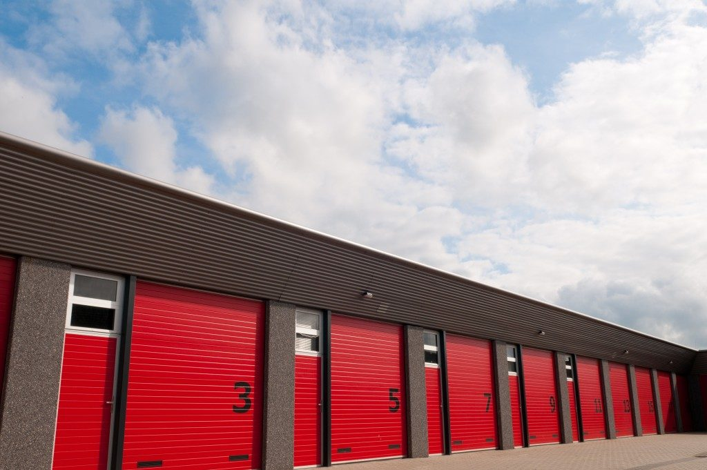 storage unit with red garage doors