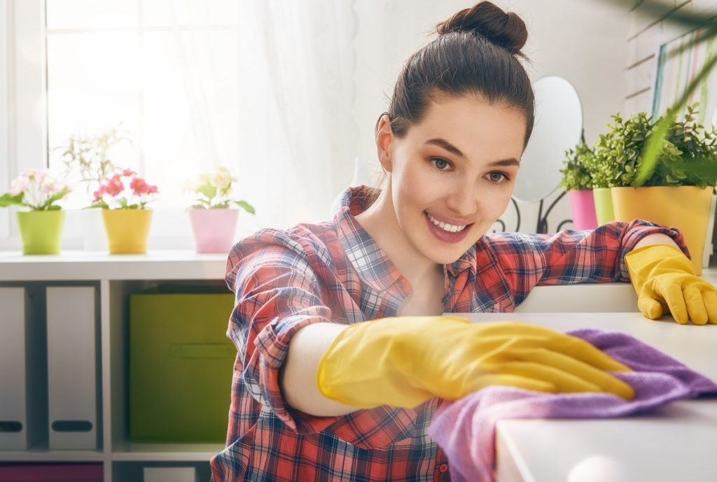 Woman wiping and cleaning surface