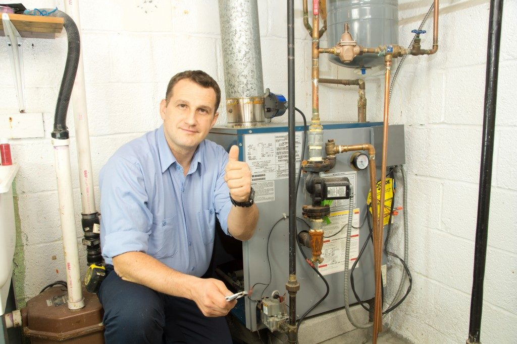 repair man done with fixing furnace