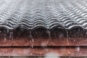 rainwater falling off the roof