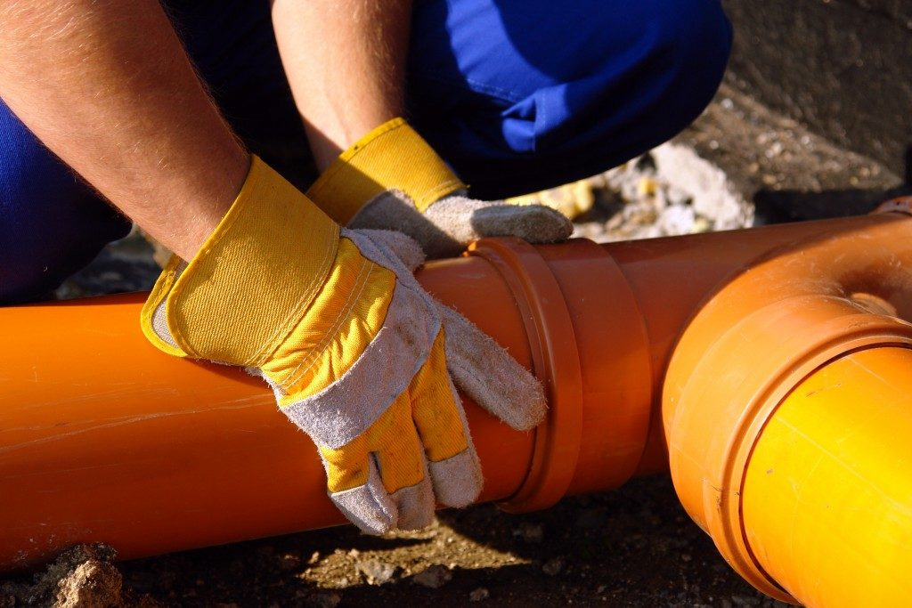 sewer pipes being repaired