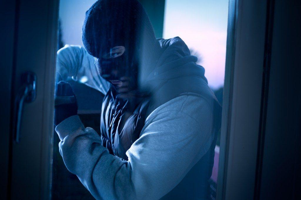 Burglar attempting to go inside
