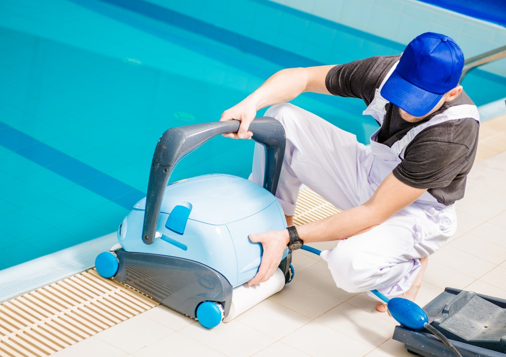 Man using a pool cleaner