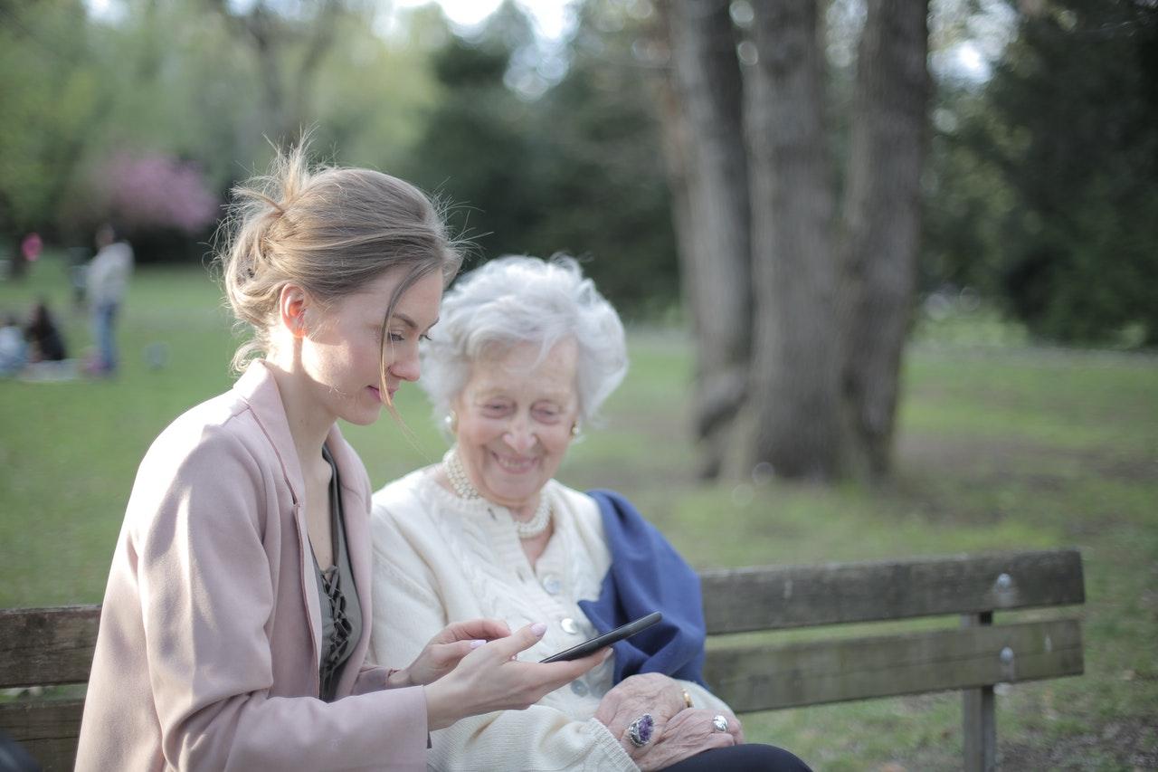 lady talking to elder woman
