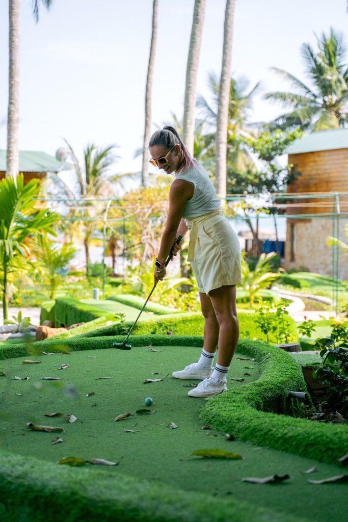 woman playing minigolf
