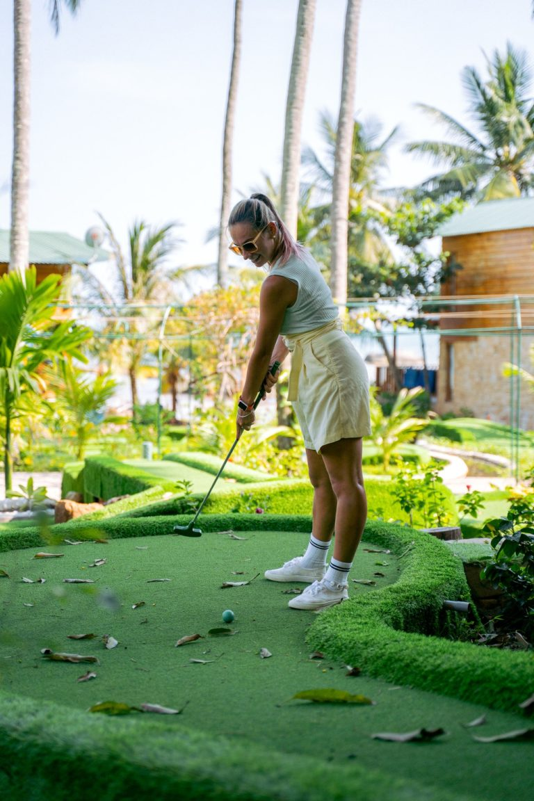 woman playing minigolf