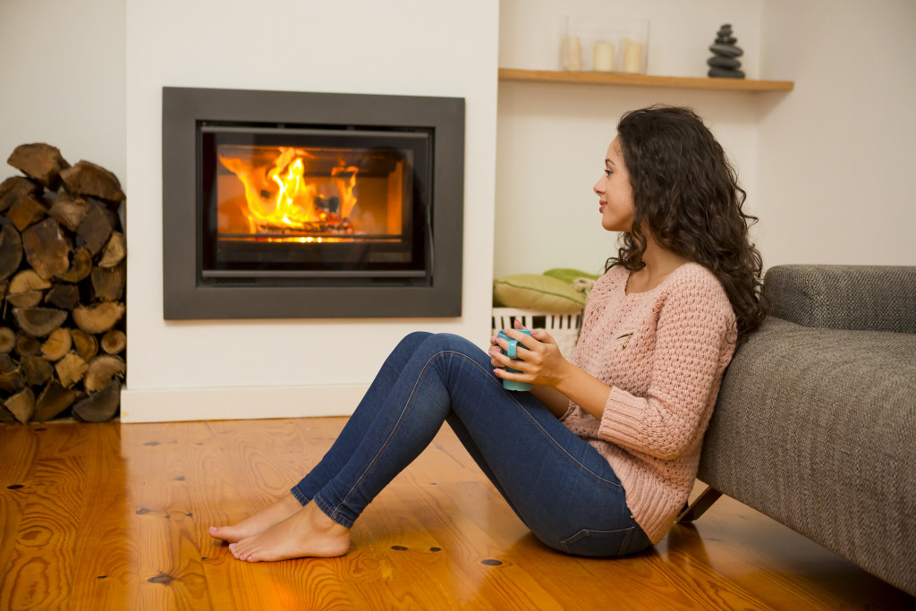 woman sitting by the fireplace